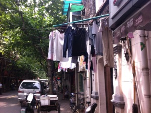 Clothes drying from apartments in Xintiandi neighborhood.